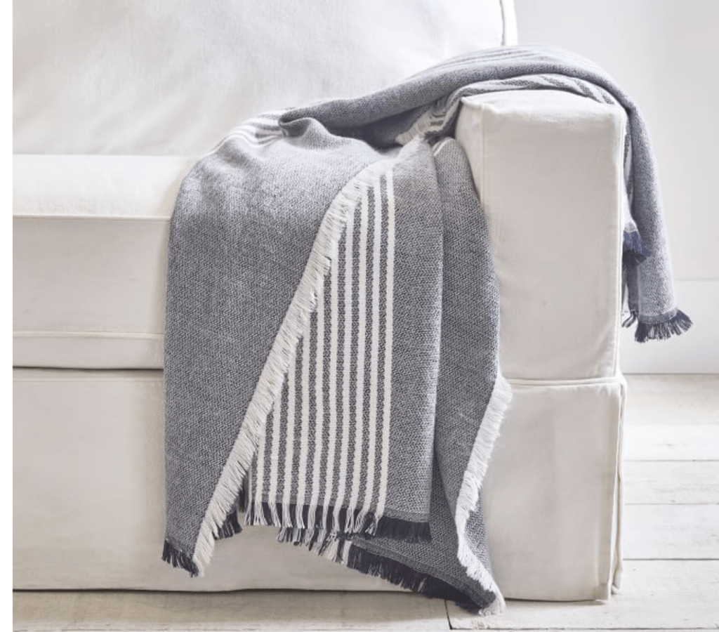 black and white striped throw blanket on sofa