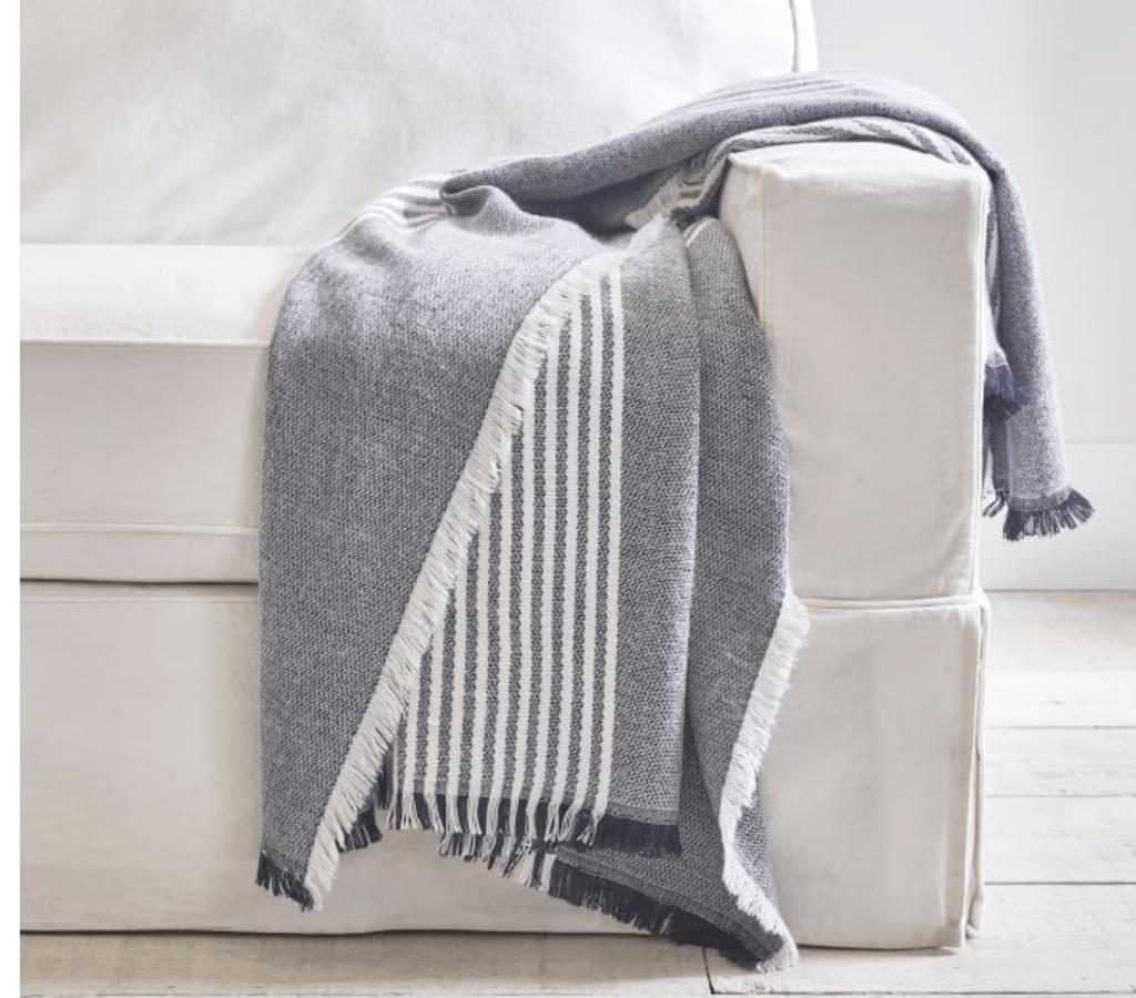 black and white striped throw blanket on sofa