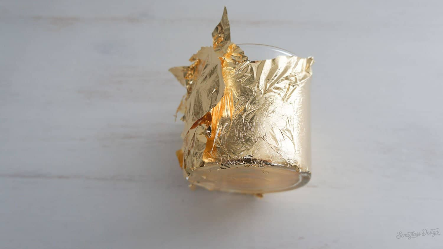 gold leaf on candle holder