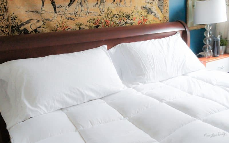 feather mattress topper on bed