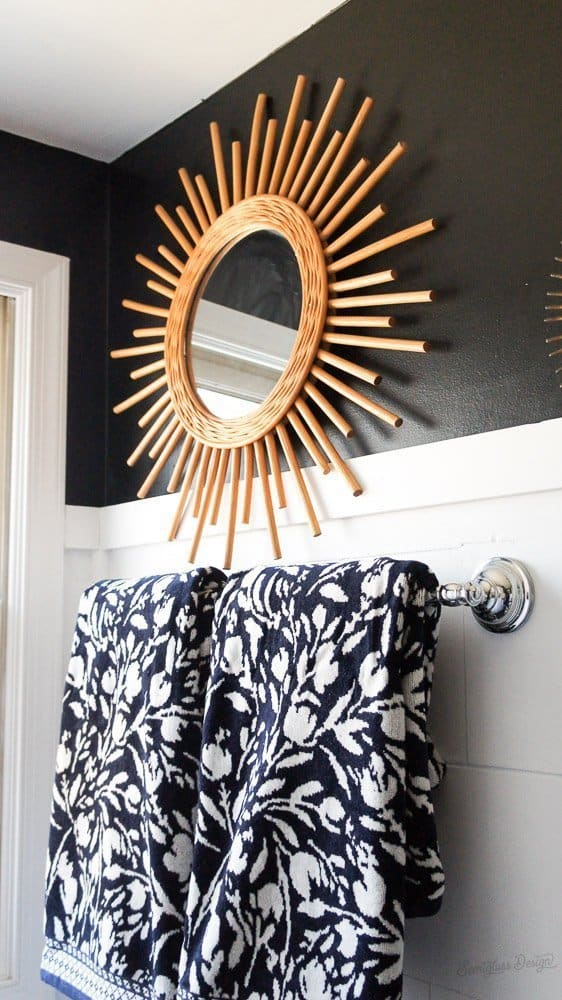 patterned towels and boho mirror