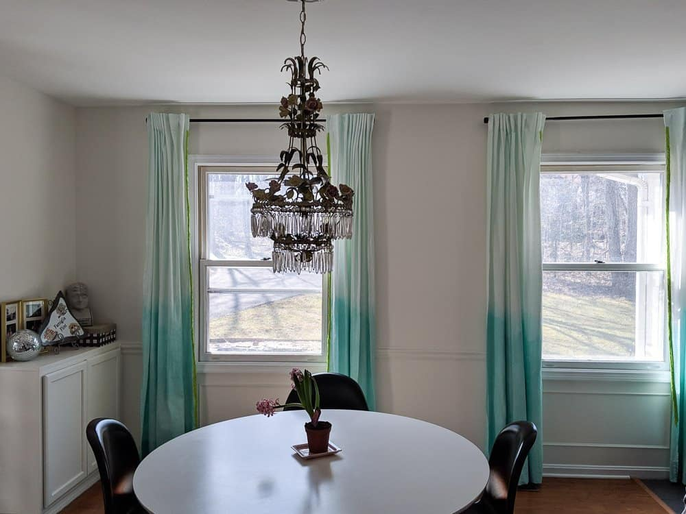 Dining room painted in Behr Swiss Coffee