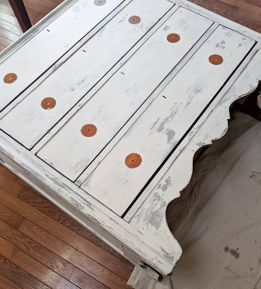 milk painted dresser laying on back