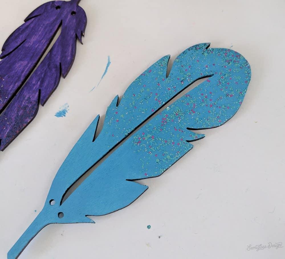 glitter paint on feathers