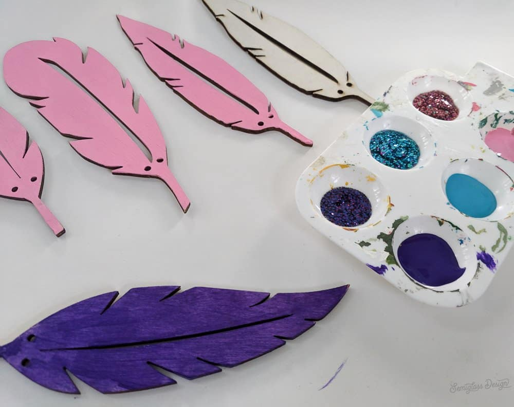 painting the wooden feathers