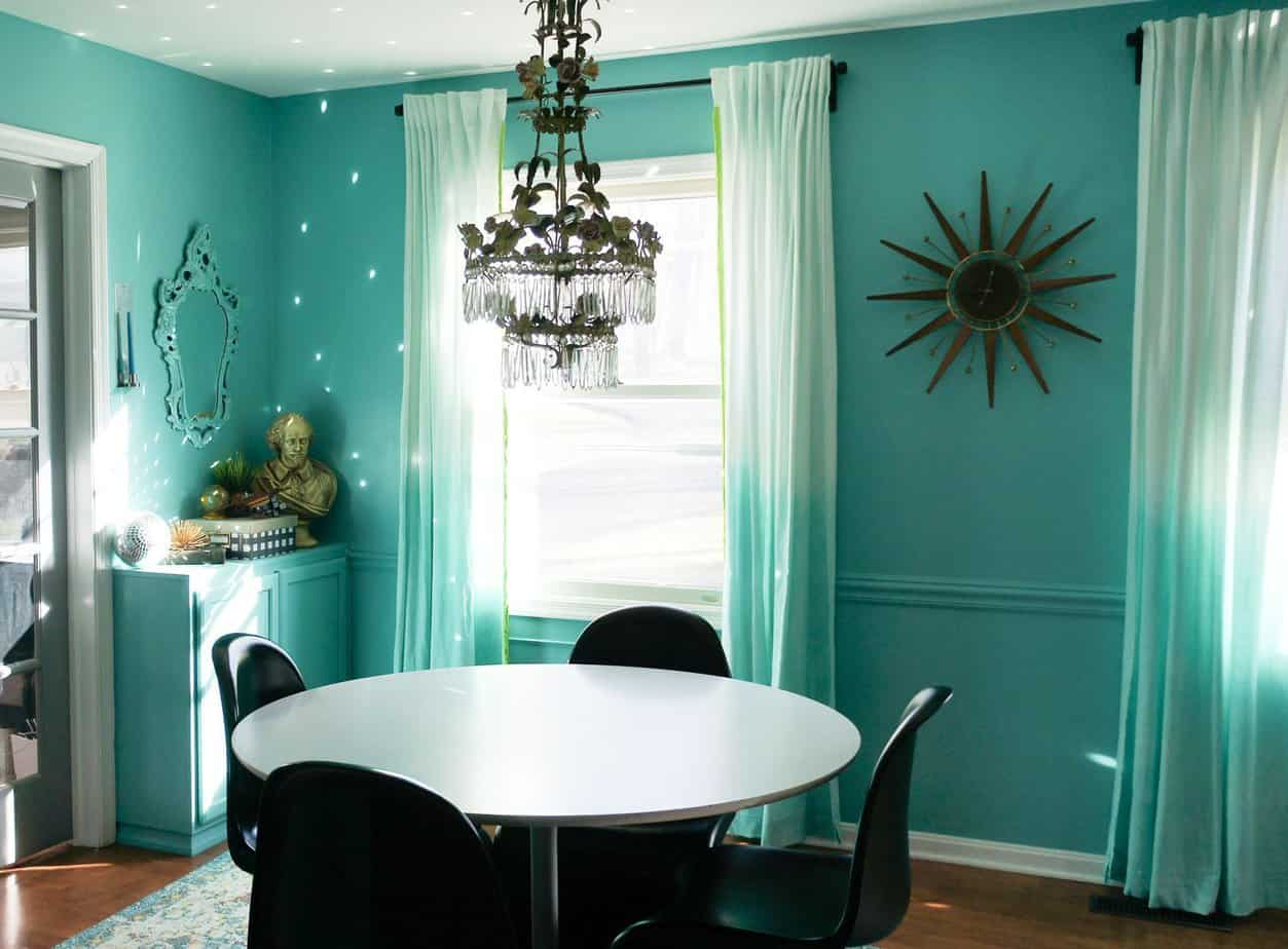 dining room before with teal walls