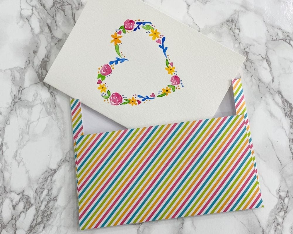 rainbow striped envelope with floral heart card