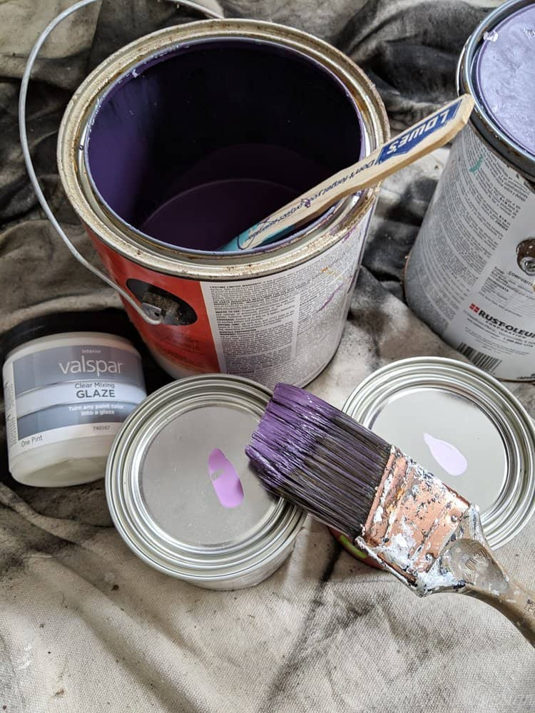 purple paint cans