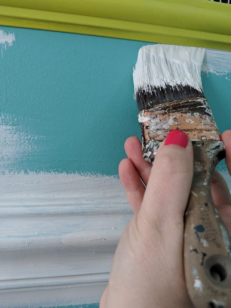 an angled paint brush helps with cutting in
