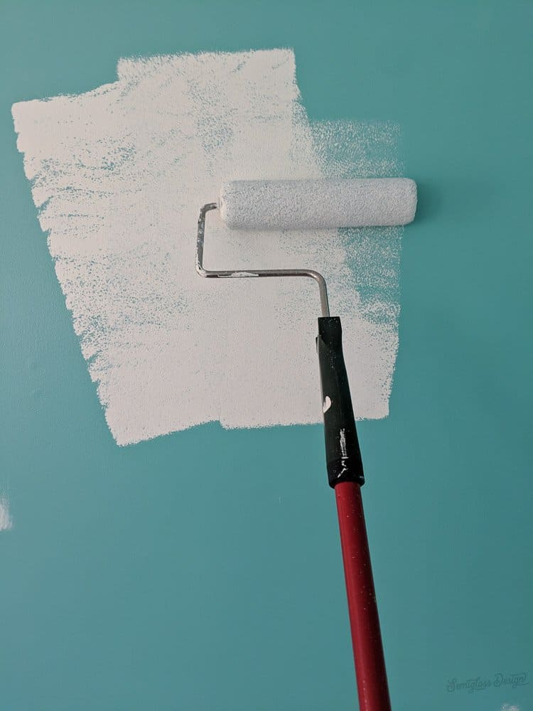 painting white on teal wall