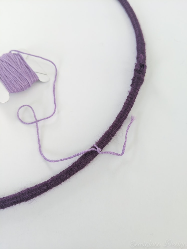 tying on embroidery floss to yarn wrapped ring