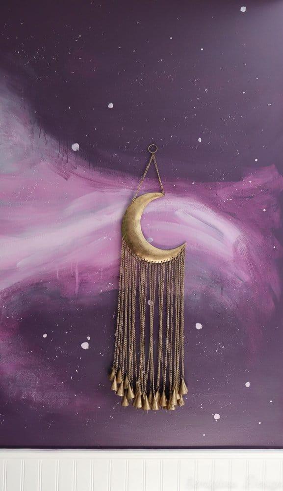moon chimes on galaxy wall in boho bedroom