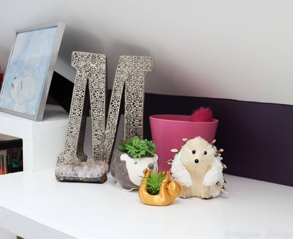 hedgehog and sloth planters in boho bedroom