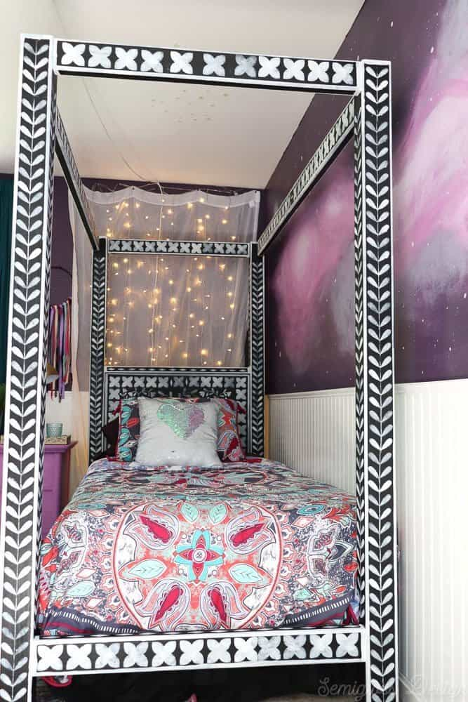 boho bedroom with twinkle lights and bone inlay canopy bed