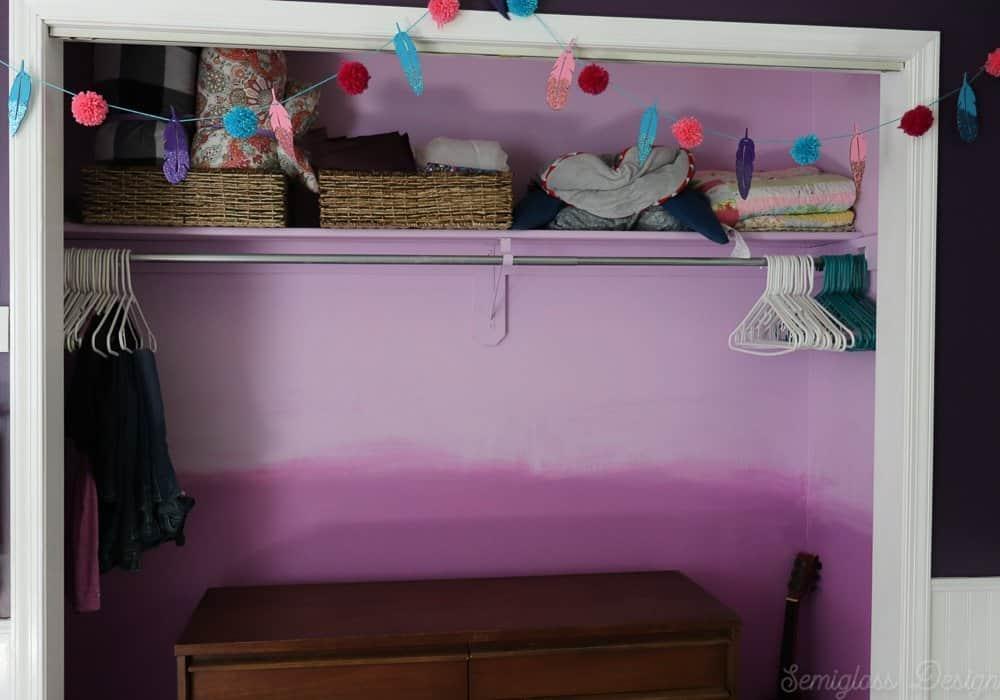 purple ombre closet with mcm dresser