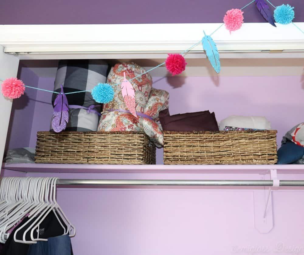 blanket storage in boho closet