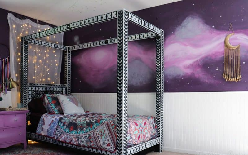 purple boho bedroom with galaxy mural and bone inlay canopy bed