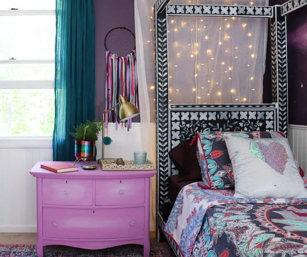 purple bohemian bedroom with twinkle lights