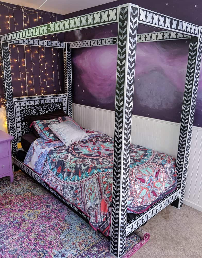 bone inlay stenciled canopy bed in boho bedroom