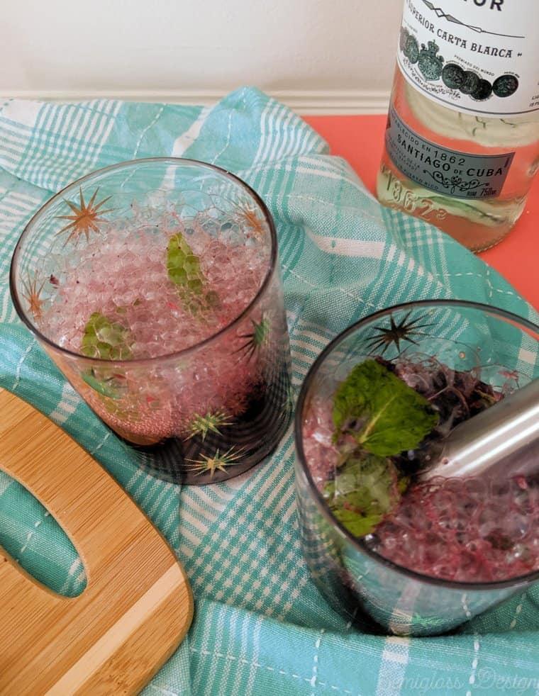 Add club soda to muddled fruit