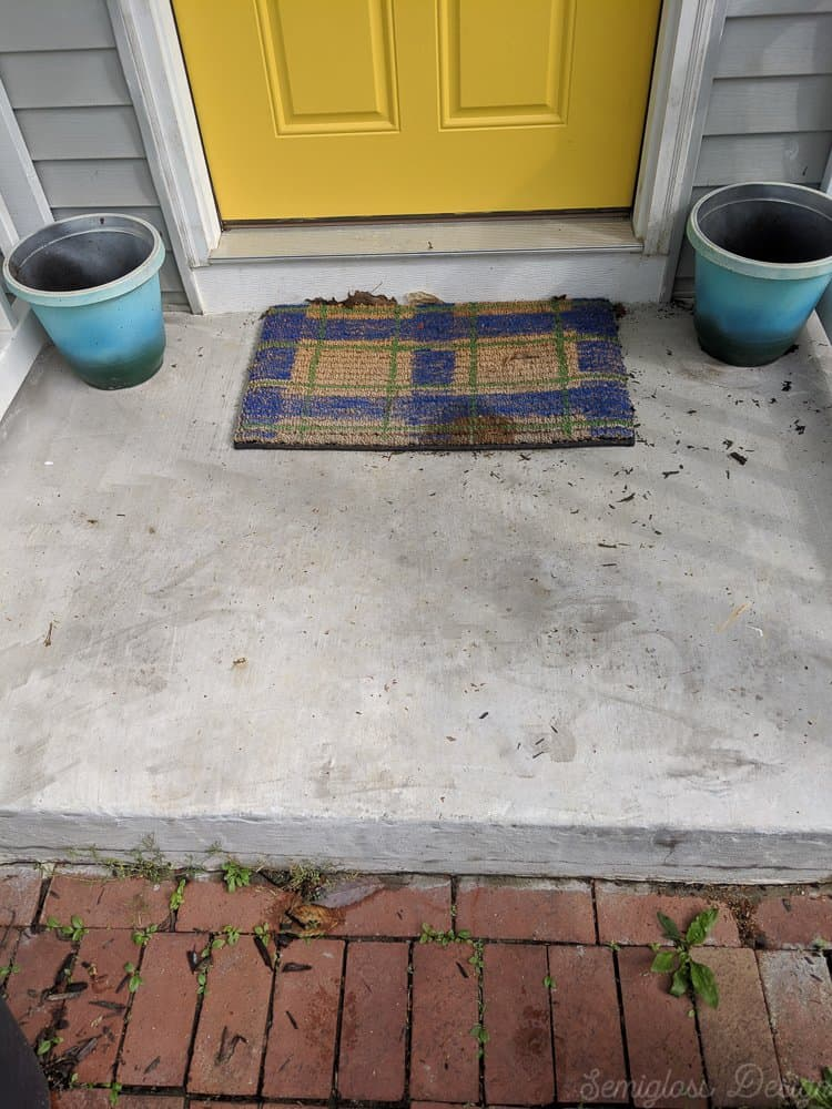 old doormat before porch makeover
