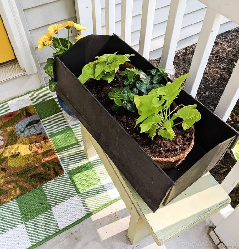 upcycled toolbox to flower planter on vintage bench for porch makeover.