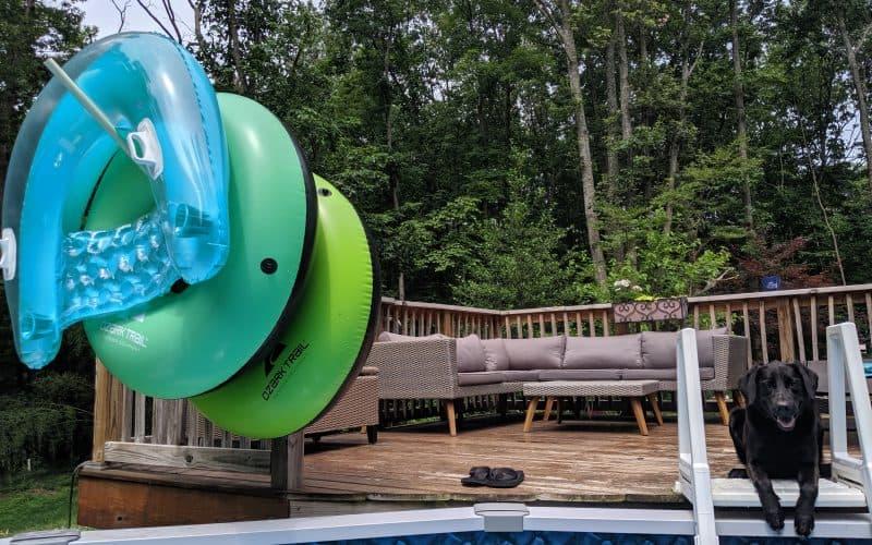 pool storage using pvc pipe on deck with cute black lab