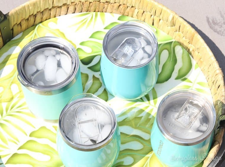 ice in insulated tumblers on a hot day