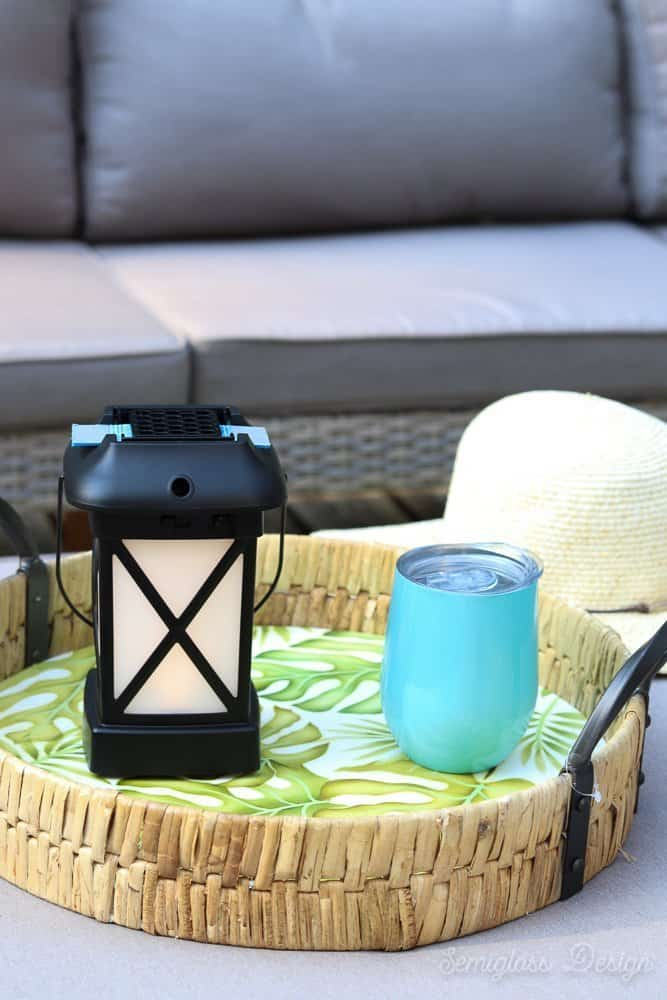 patio table with wine tumbler and lantern