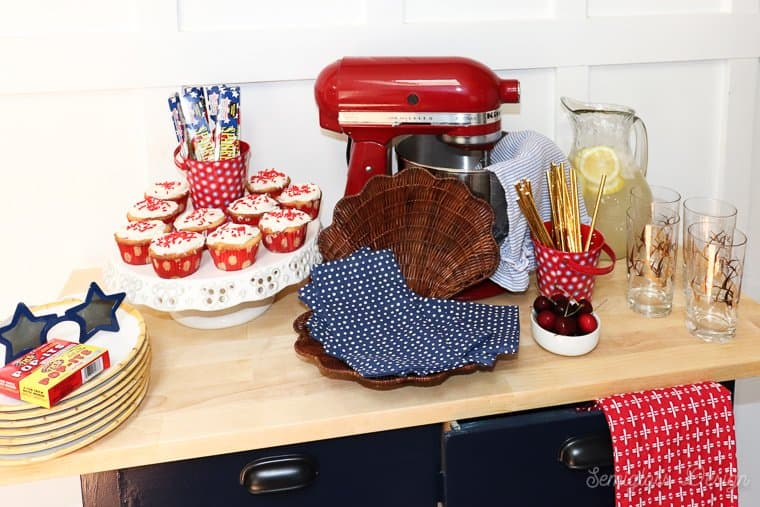 red white and blue kitchen island set up for party