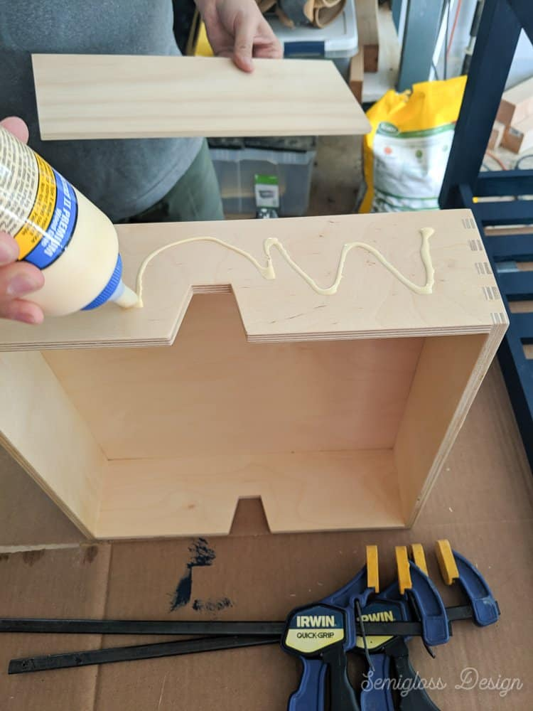 use wood glue to attach wood fronts to drawers