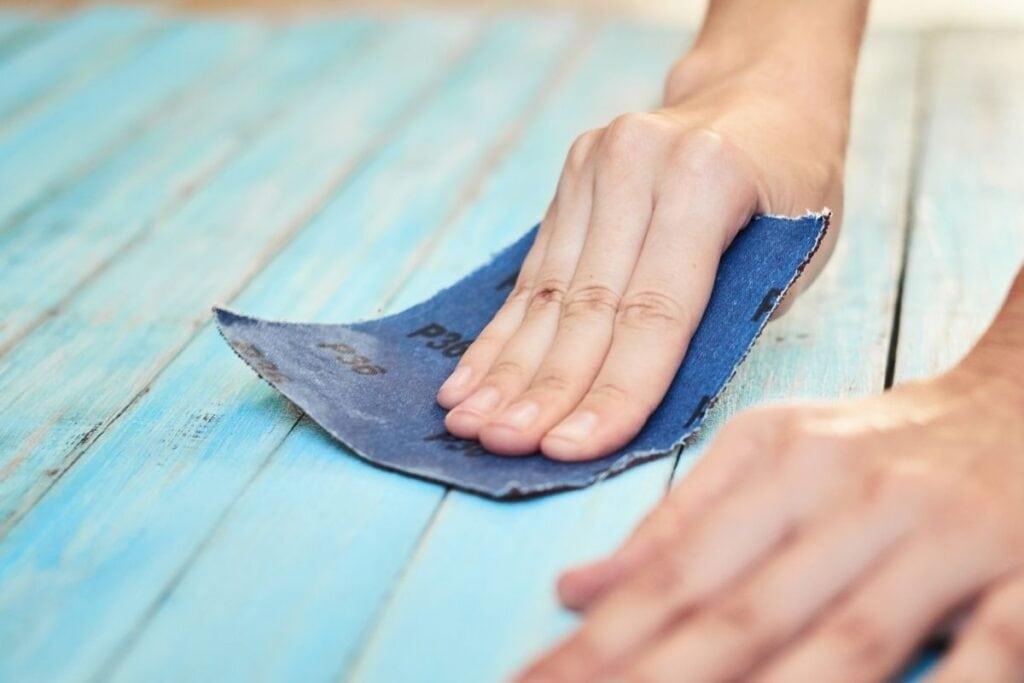 sanding blue painted wood
