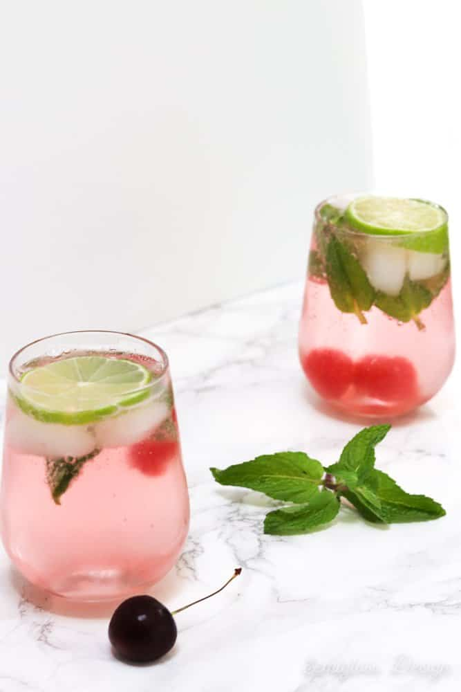 cherry mojitos in glasses with limes