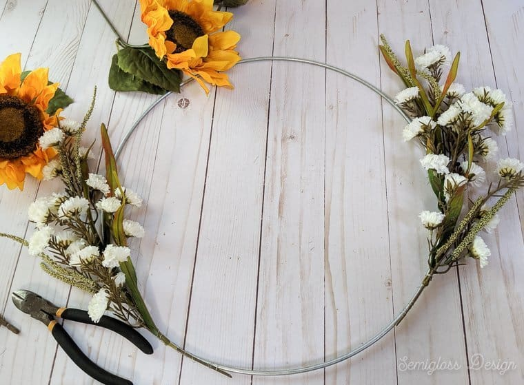 attaching flowers to wreath form with wire