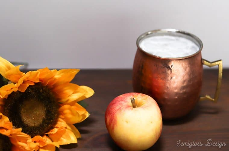 apple moscow mule in copper mug with sunflower