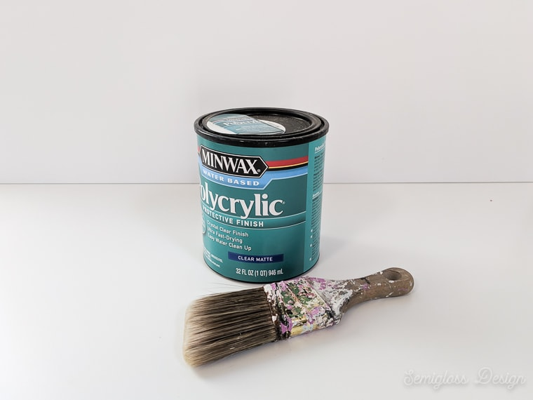 can of polycrylic and paint brush