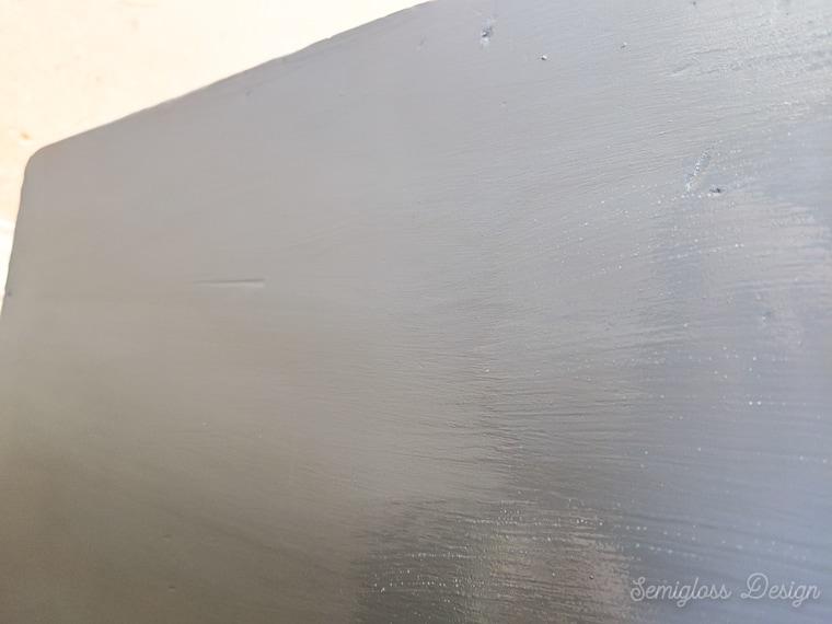 brushing long streaks of polycrylic on dresser