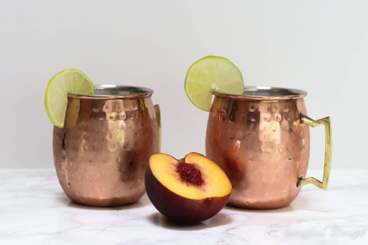 peach moscow mules in copper mugs
