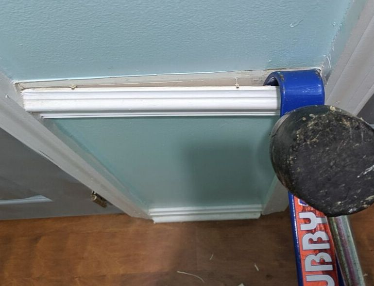 removing chair rail with pry bar