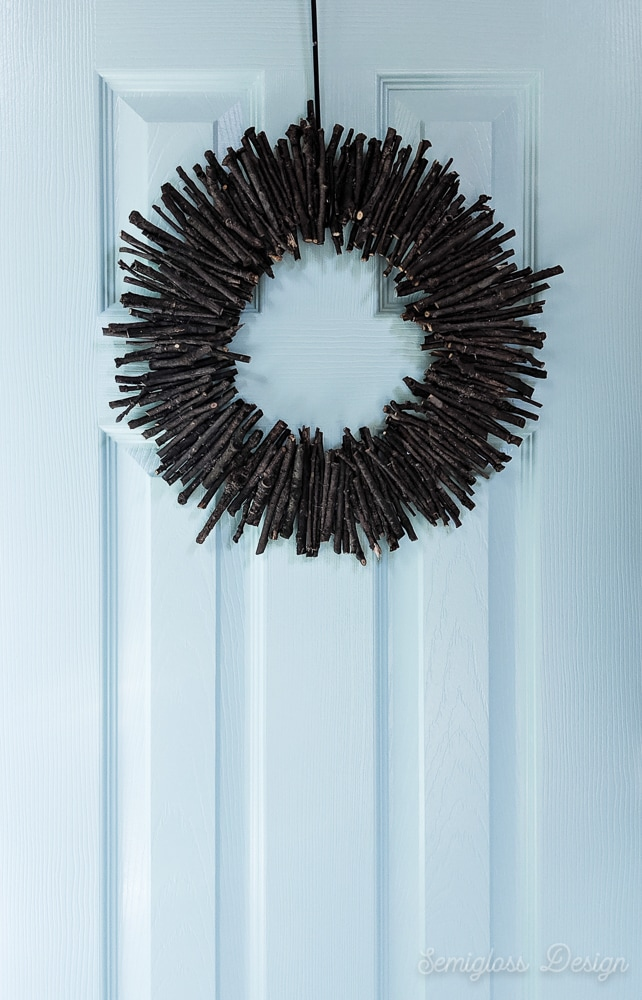 modern, rustic twig wreath on aqua door