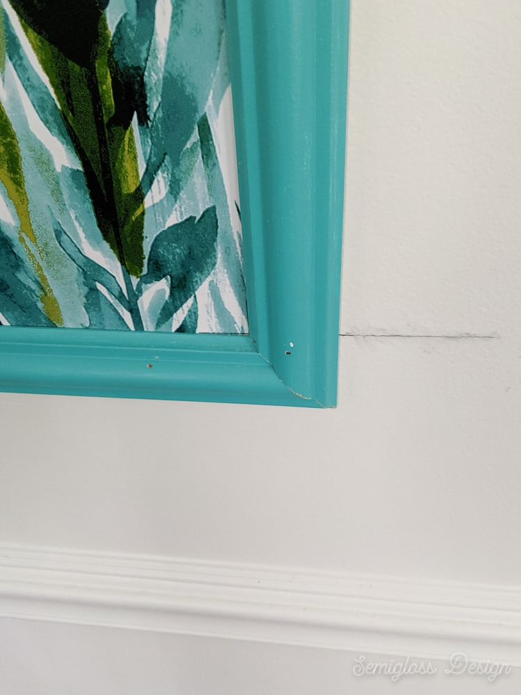 nail holes and cracks at corner of frame to be filled