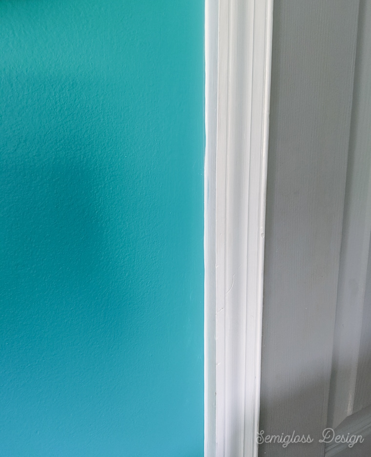 white painted trim against teal walls
