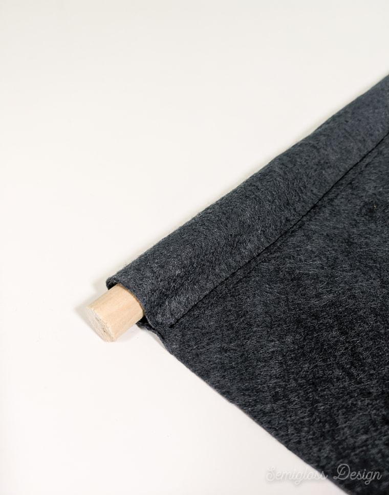 dowel in pocket on felt banner