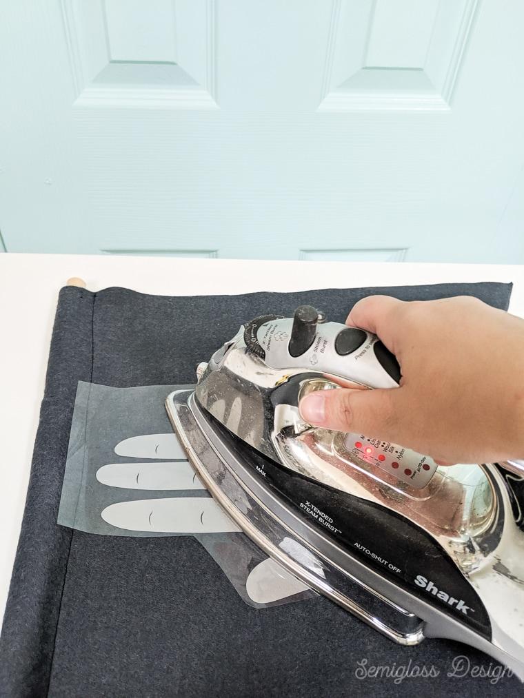 ironing htv onto felt banner