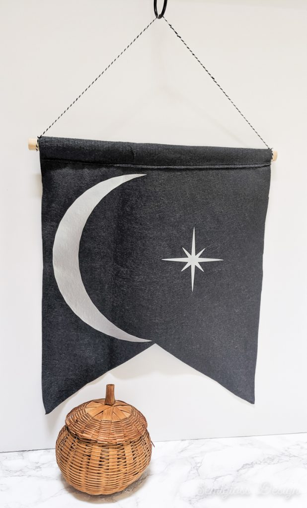 moon and star banner with wicker pumpkin