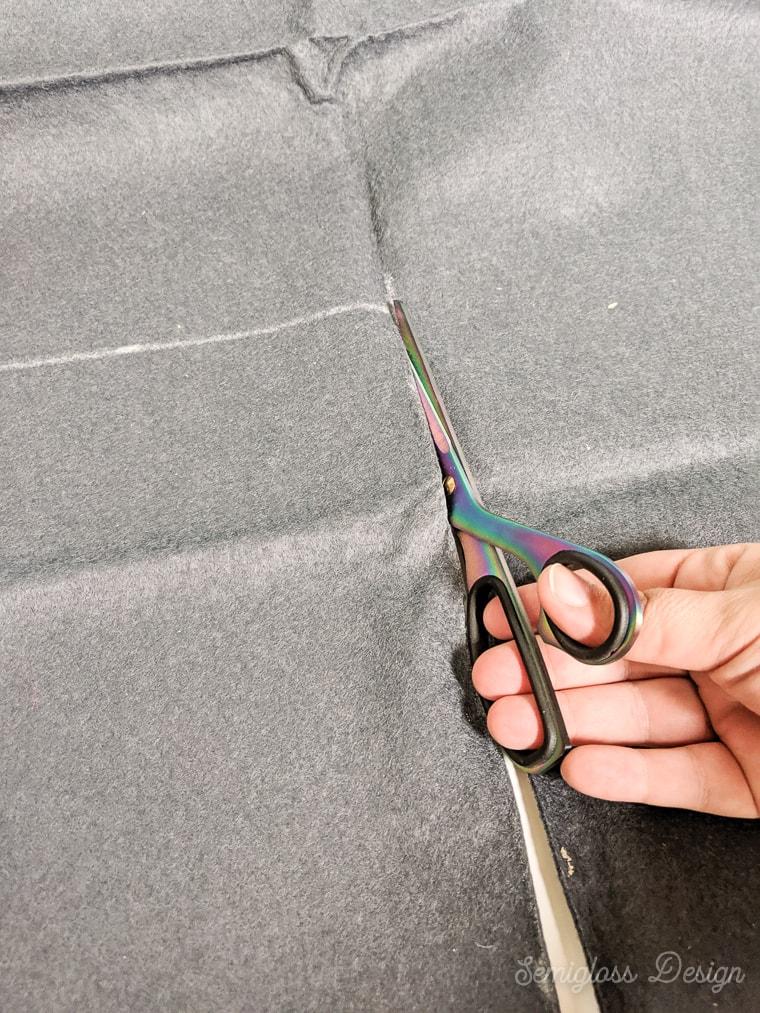 cutting gray felt for banner