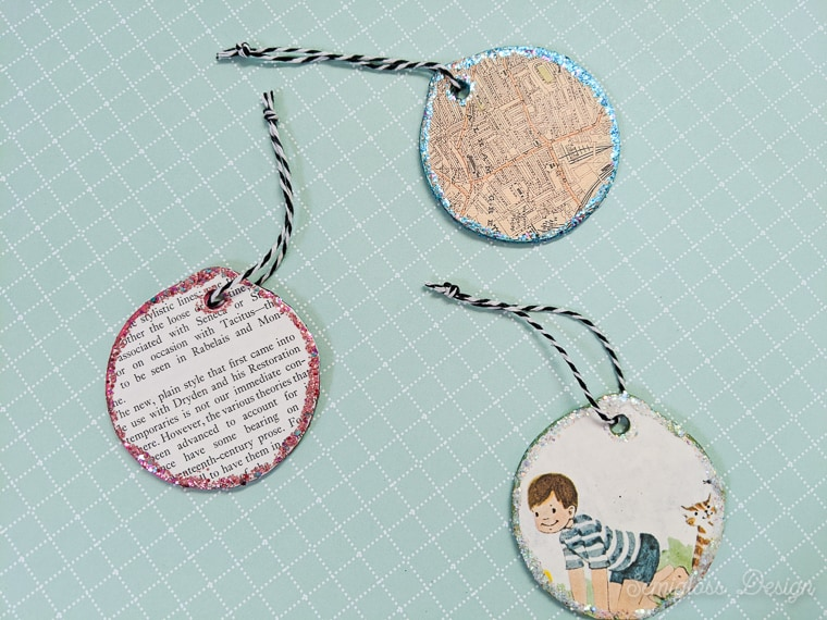wood ornaments decoupaged with vintage paper