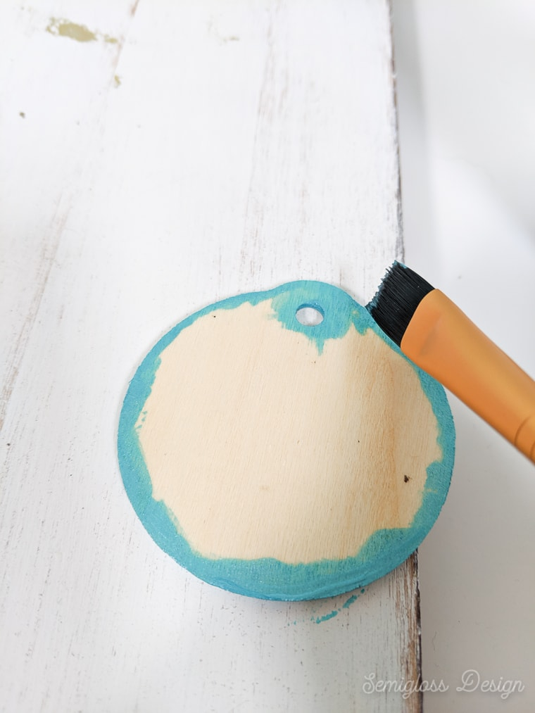 painting edges of wood ornament blue