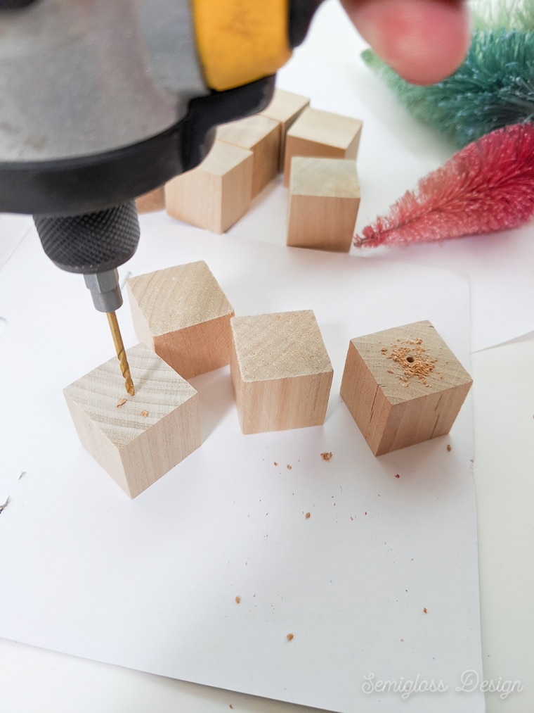 drilling holes in wooden blocks for bottle brush tree bases