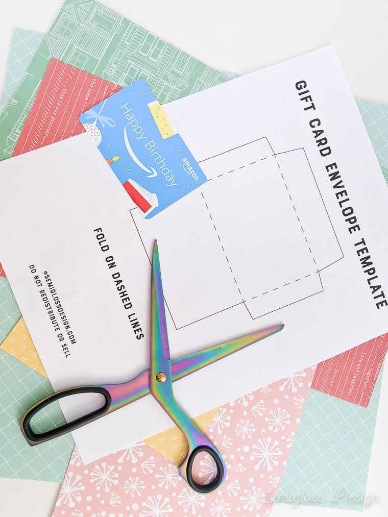paper and scissors for making a gift card envelope